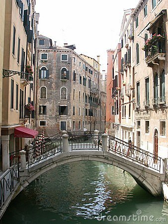 Back alley and pedestrian bridge in Venice Italy