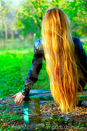 Back of blond woman with long beautiful hair