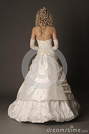 Back of bride in wedding dress.