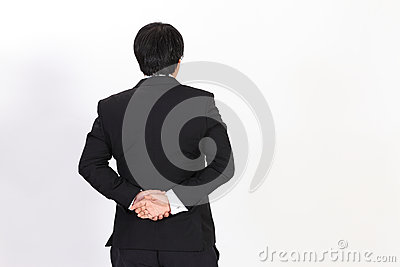 back of business man in black suit looking
