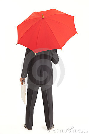 Back of businessman with red umbrella and laptop