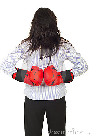Back of businesswoman hiding gloves