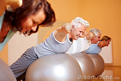 Back exercises on Swiss balls