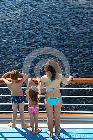 Back of family standing on deck of ship