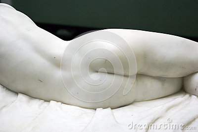 Back of femine marble statue.