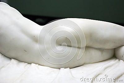 Back of femine marble statue.