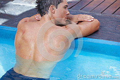 Back of man in swimming pool