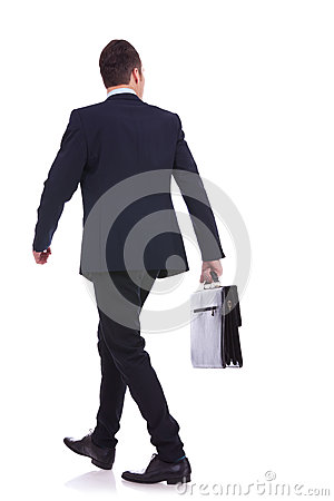 Free Back Of A Walking Business Man Holding A Briefcase Royalty Free Stock Image - 25949586