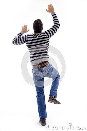 Back pose of dancing climbing man