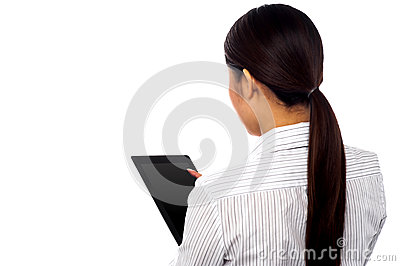 Back pose of a woman operating touch pad device
