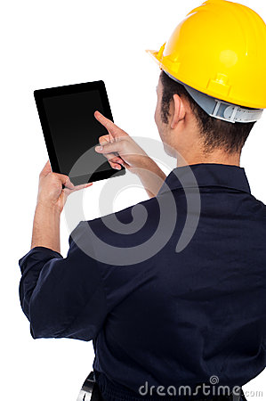 Back pose of worker operating tablet device
