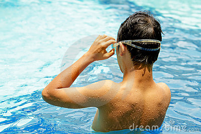 Back of teen boy at swimming pool
