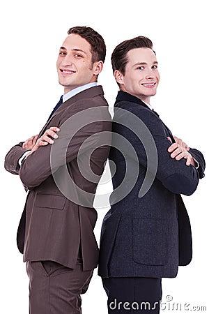 Back to back businessmen smiling