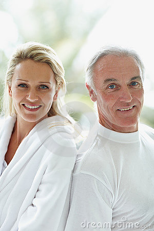 Back to back - Portrait of a mature couple smiling