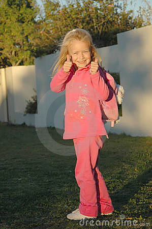 Back to school girl in pink Stock Photo