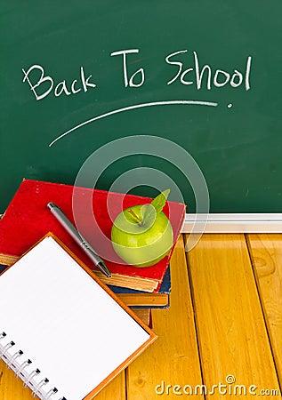 Back to school written on chalkboard.