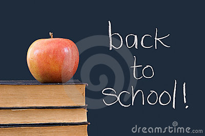 Back to school written on chalkboard wiith apple,