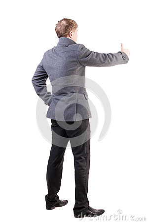Back view of  business man in coat shows thumbs up