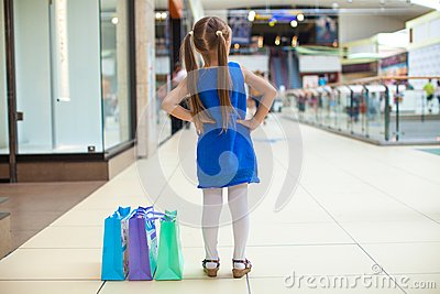 Back view of fashion girl with packages in