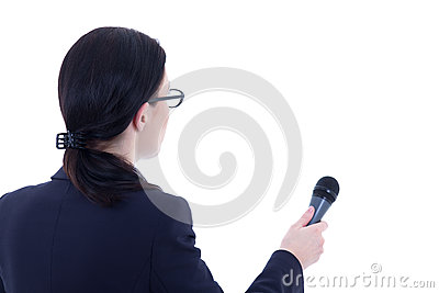 Back view of female reporter with microphone isolated on white