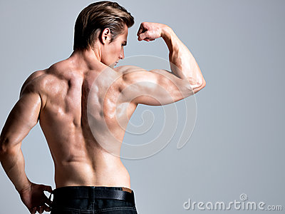 Back view of handsome man with muscular body.