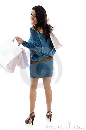Back view of happy model holding carry bags