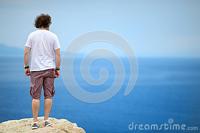 Back view of a man looking to the ocean
