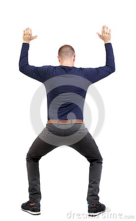Free Back View. Man  Protects Hands From What Is Falling From Above. Royalty Free Stock Photo - 108727805
