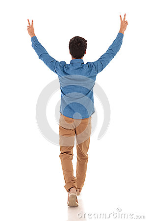 Free Back View Of A Casual Man Celebrating Victory And Walking Royalty Free Stock Photo - 92009895