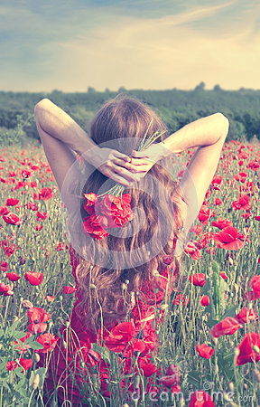 Free Back View Of A Young Woman With Long Blonde Hair In A Red Dress Holding A Bouquet Of Flowers In A Poppy Field Stock Photography - 78854622