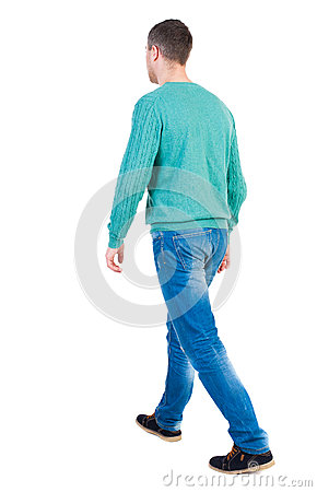 Free Back View Of Going  Handsome Man In Jeans And A Shirt. Royalty Free Stock Image - 61394666