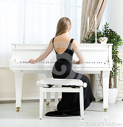 Free Back View Of Musician Sitting And Playing Piano Stock Images - 34419284