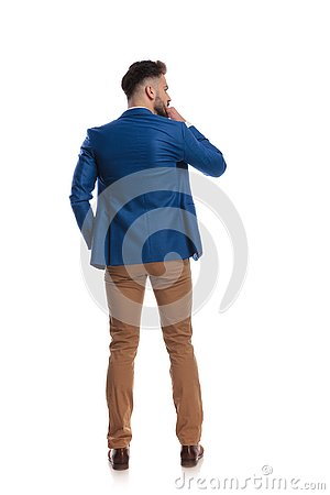 Free Back View Of Smart Guy Thinking With Hand At Chin Stock Photography - 146666682