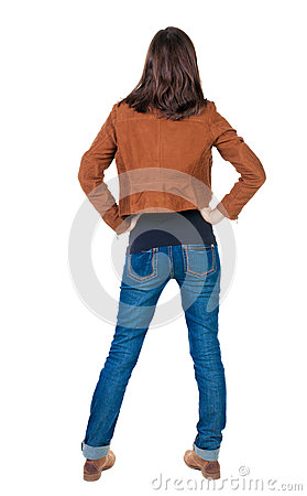 Free Back View Of Standing Young Beautiful Brunette Woman In Brown J Stock Images - 51311054