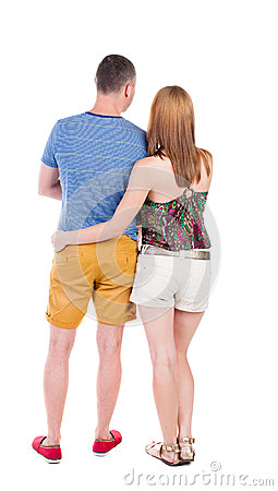 Free Back View Of Young Embracing Couple In Shorts  Hug And Look. Royalty Free Stock Images - 44369349