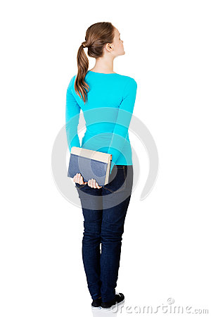 Free Back View Of Young Student Woman Holding An Old Book. Royalty Free Stock Images - 33065279