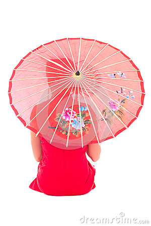 Back view of sitting girl in red japanese dress with umbrella is