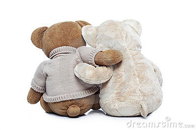 Back view of two Teddy bears hugging each other