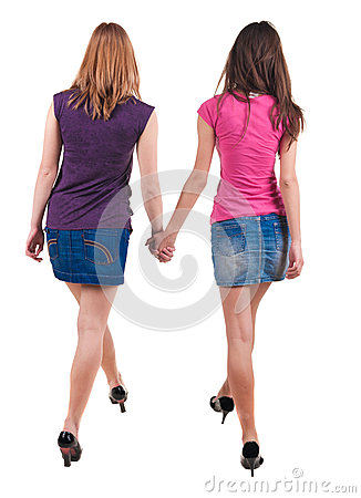 Back view of two  young women walking