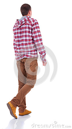 Back view of walking  teenager in plaid shirt with hood