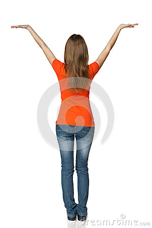 Back view of young casual female in full length holding blank copy space