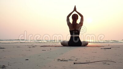 back of views woman practice yoga lotus pose to meditation