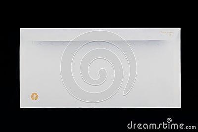 Back of a white envelope on black background