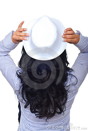 Back of woman with curly hair and hat