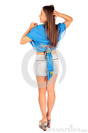 Back of woman dressed in shorts and pareo