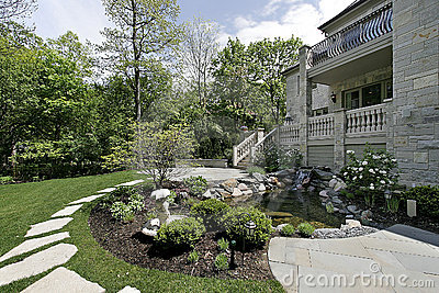 Back yard with stone patio