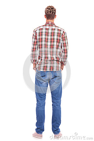 Back of young man hands in pockets