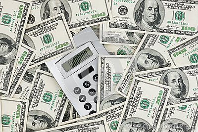 Background of $ 100 bills and a calculator