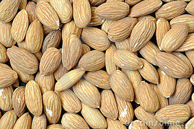 Background with almonds. Close up.