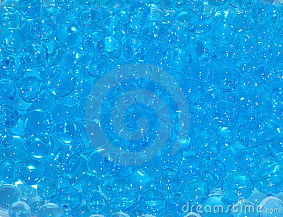 Background of blue gel balls of polymer in water